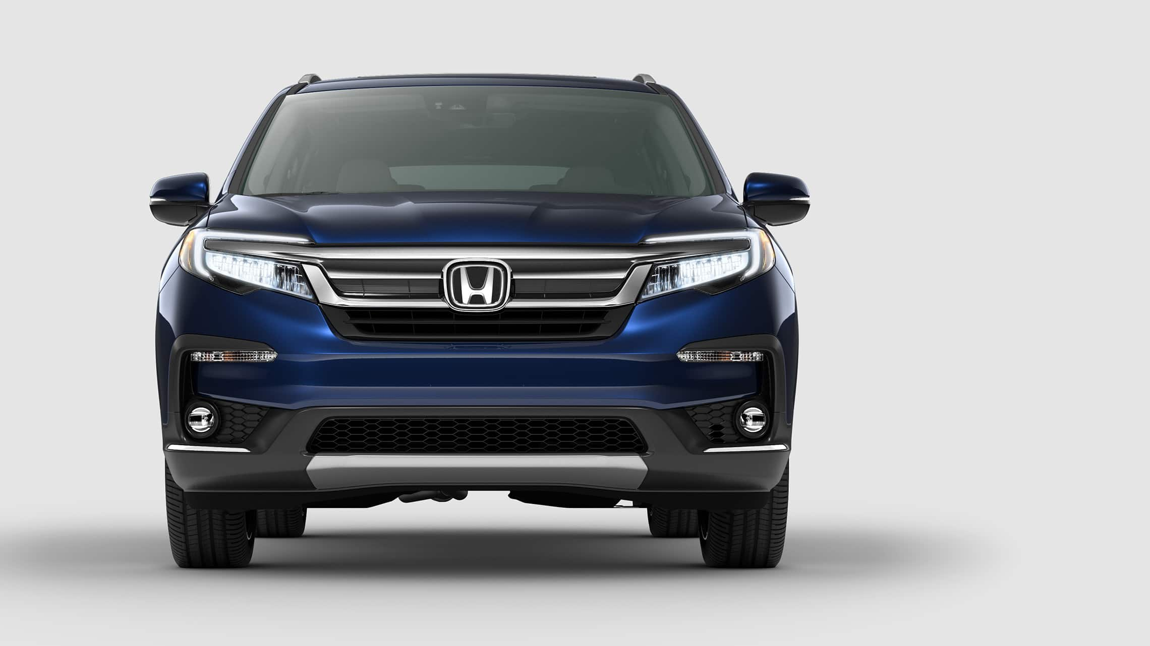 Straight front view of 2021 Honda Pilot Elite in Obsidian Blue Pearl.